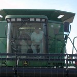 Emil Kemmler on a corn harvester in Hartfort City, IN