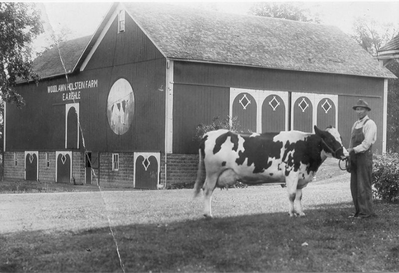 Ernest Riehle, son of Johann Adam Riehle, in front of his barn in Edgerton